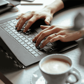 Women working from home using her laptop, typing a mail message